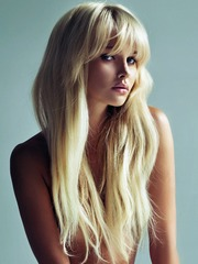 Her silky blonde hair is long and..