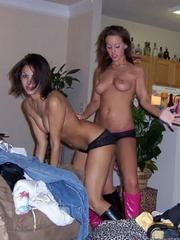 Four girls having fun topless in beach