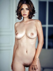 Curly naked babe with a juicy body and..