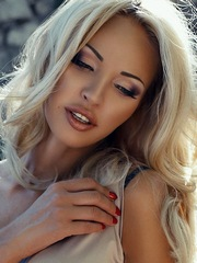 Charming blonde with long eyelashes
