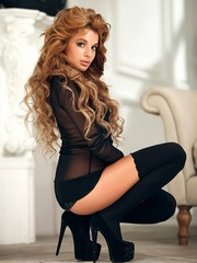 Curly haired babe secretary in black..