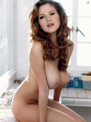 Red-haired naked girl with curly hair,..