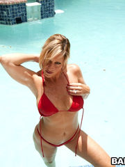 Cougar Jodi takes off her swimsuit..