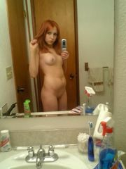Red-haired college girl with a  assets..