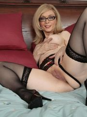 Nina Hartley posing in ebony stocking -..