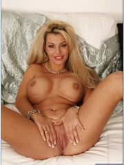 Luxury blonde cougar with meaty breasts..