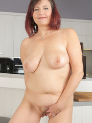 Older chick Justina does a striptease..