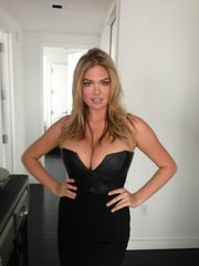 Kate Upton's sundress can barely..
