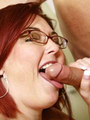 Plump ginger-haired is pounding in a..