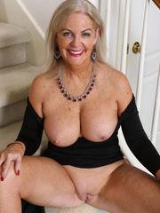 Elegant mature Judy Mayflower displays..