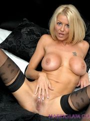 Huge-boobed cougar  in stockings..