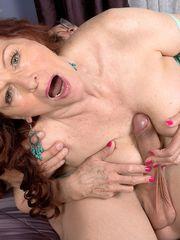 Redheaded  Katherine Merlot sports a..