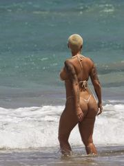 Amber Rose Bare-breasted Swimsuit And..