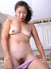 mature chinese woman home from tennis..