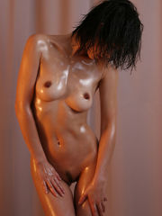 An Asian lubed up female from D