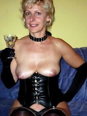 Mature doll in leather harness and..