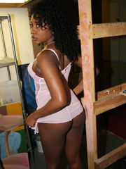 Curly-haired black lady  up getting..