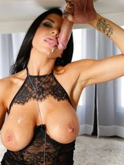 Buxom masseur Romi Rain in ebony lace..