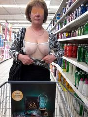 Joyful women displaying bosoms and..