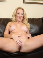 Alana Evans peels off and poses in..