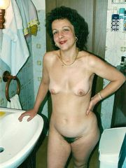 Bizarre mature unveiling her hairy cunny