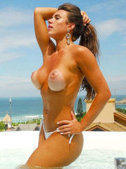 Nicole Bahls lets tanned boobies come..