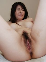Mischievous asian Cougar with furry..