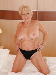 Smiley platinum-blonde granny getting..
