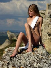 Slim long-legged dame posing on the..