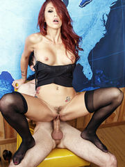 Stockinged red-haired Monique Alexander..