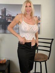 Mature blonde in see-through dark-hued..