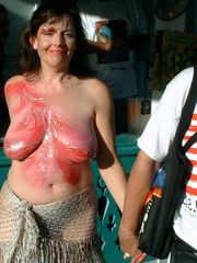 Body art on naked boobs at summer..