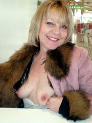 Slim granny exhibitionist at home and..