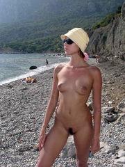 Crimean doll nude on public beach off..