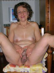 Weird mature exposing her hairy gash
