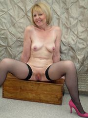 Slim grannie exhibitionist at home and..