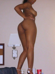 Nasty ebony super-bitch posing bare in..
