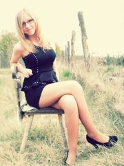 Cute young Grind ash-blonde teenager in..
