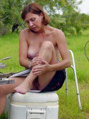Folks display topless photos of their..