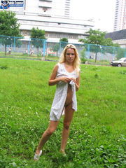 Blondie naked on green grass in public..