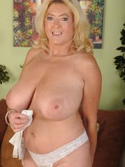 Platinum-blonde gal frolicking with her..