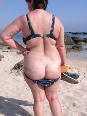Mature naturist in the pool and on the..