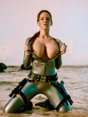 Lara Croft hottie undress on beach -..