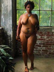 Naked, Phat ebony  with a massive arse..