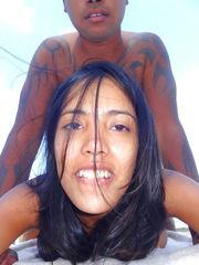 A tiny swarthy bitch inhales on the beach