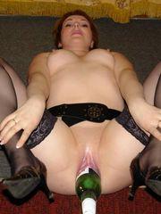 Wild mature gals stuffing vaginas with..