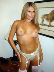 Beddable Blonde MILF posing with rose..