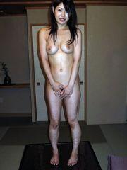 Super-cute oriental female slowly peels..